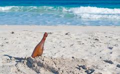 Bottle by the foreshore Stock Photos