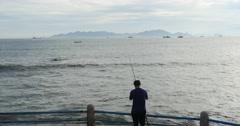 4k Man fishing on the coast. Stock Footage