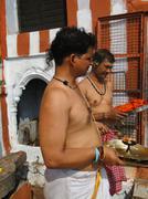 Brahmin priests of shiva prepare sacred fire for ceremonies . Stock Photos