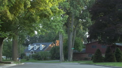 Driving plate, rear view, day: wealthy neighborhood A - stock footage