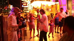 LAS VEGAS - PEOPLE WALKING BY ELVIS STATUE Stock Footage