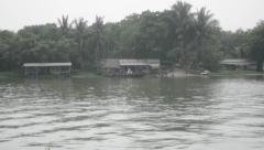 People crossing the river Kwai on a primitive ferry Stock Footage