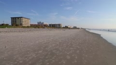 Slow Pan of a wide open beach in famous Cocoa Beach, Florida Stock Footage