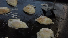 Fried eggs on black iron grill 4K 080 Stock Footage
