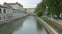 Boats with tourists float on the river Ljubljanica, Slovenia. Stock Footage
