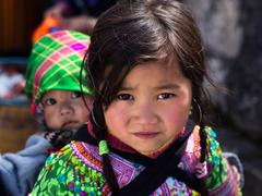 Unidentified Hmong Girl Carrying Baby in Sapa, Lao Cai, Vietnam - stock photo