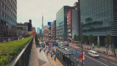 People walking in the Minato ward of Tokyo, Japan outside Daimon Station. This Stock Footage