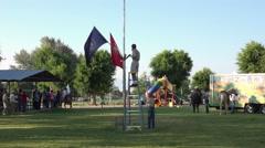 Rural town celebration patriotic flag ceremony 4K 075 Stock Footage