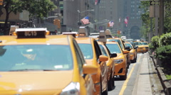 Cars yellow cabs traffic on Park Avenue in New York City Stock Footage