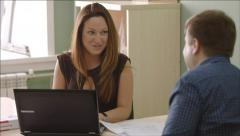 Manager works with a client in the office - stock footage