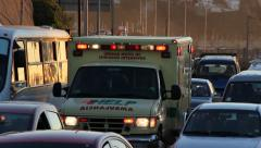 Ambulance in a traffic jam - stock footage