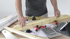 A man made a piece of furniture with various carpentry tools Stock Footage