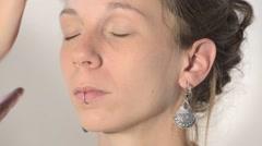 Applying face powder Stock Footage