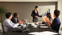 Asian female leading successful presentation. Chart showing constant growth. - stock footage