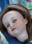Scary doll face in an antique shop Stock Photos