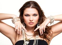 Stock Photo of beautiful young woman in necklace