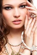 beautiful young woman in necklace - stock photo
