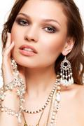 Beautiful young woman in necklace Stock Photos