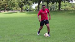 Soccer player dribbles Stock Footage