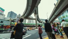 People and traffic time lapse at a big intersection in Tokyo - stock footage
