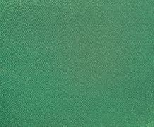 Texture of a green woven synthetic waterproof fabric Stock Photos