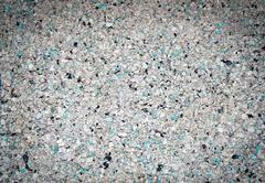 Background of small blue, gray, white and black small granules with vignettin Stock Photos