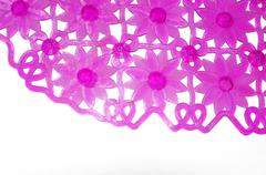 Purple rubber mat for bath with flower pattern as background Stock Photos
