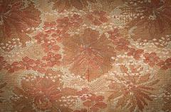 Old tapestry fabric tinted sepia with vignetting effect as background Stock Photos