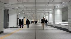 T/L People walking in the Shinjuku underground, Tokyo, Japan Stock Footage