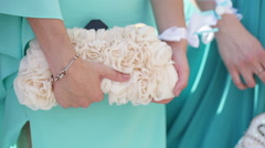 Girl at a wedding reception held clutches Stock Footage