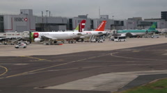 Plane Taxiing at Gatwick Airport Terminal Stock Footage