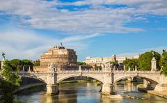 castel sant'angelo with bridge by day and blue sky - stock photo