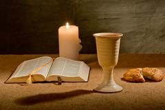 Chalice of wine and bible Stock Photos