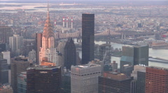 Aerial view New York City Chrysler skyscraper Queensboro Bridge sunset USA NYC  - stock footage