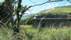 Abandoned stone houseby the sea and cliffs Stock Footage