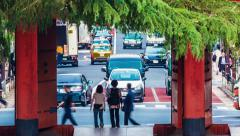 People and cars pass by the gateTokyo of a temple in the Stock Footage