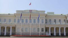The Presidential Palace of Lithuania in Vilnius, flags Stock Footage