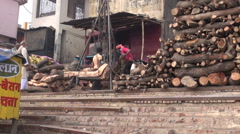 Weighing firewood in sacred city Varanasi for cremation ritual, India Stock Footage