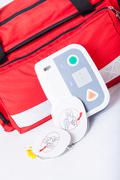 defibrillator in first aid kit - stock photo