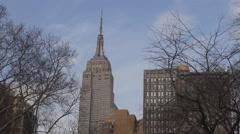Empire State building tower blue sky spring Manhattan landmark New York City day Stock Footage