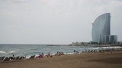 BARCELONA BEACH WITH BUILDING Stock Footage