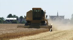 Wheat harvest in the northern sea clay area of Groningen, The Netherlands Stock Footage