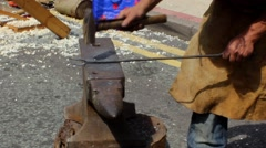 Blacksmith forges a piece of metal on the anvil 2 Stock Footage