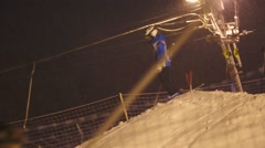 Ski riders on mountain top ride down in snowing day - stock footage