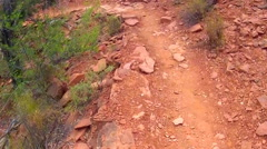High Angle POV Walking Rocky Trail In Red Rock Country Stock Footage