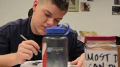 Student in Uniform at Desk Stock Footage