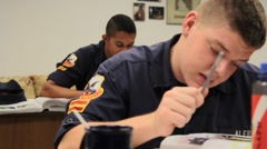 Uniformed Students Taking a Test Stock Footage