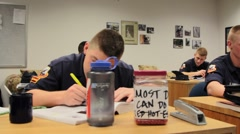Uniformed Students Writing in Notebooks Stock Footage