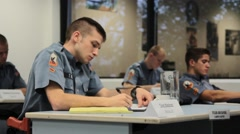 Uniformed Students Taking Notes Stock Footage