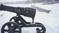 Winter view of Onega lake quay and old cannon, slider Stock Footage